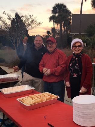 Nic Porter, Kathleen & Larry Buchman lending a hand
