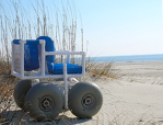 This image has an empty alt attribute; its file name is wheelchair-beach-8-19-20.png